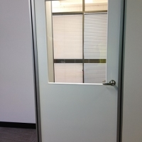 Door with large glass viewing panel